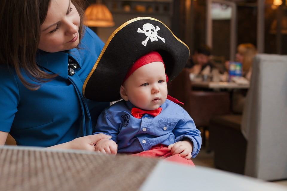 little kid in a pirate costume