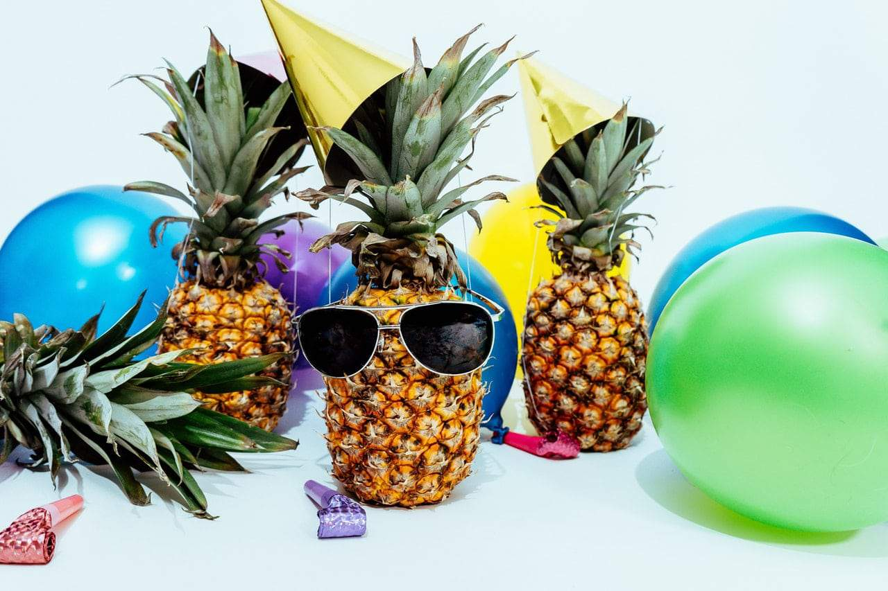 pineapples with sunglasses acting too cool for the room -- pretend to have forgotten your friend's birthday until you're ready to spring the surprise birthday party ideas