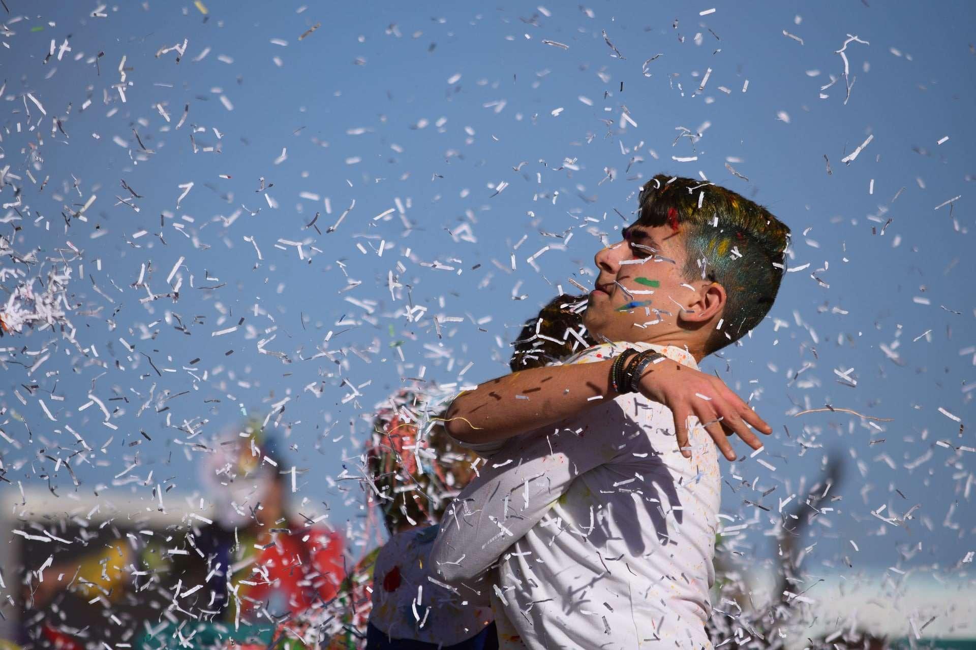 boys standing in confetti