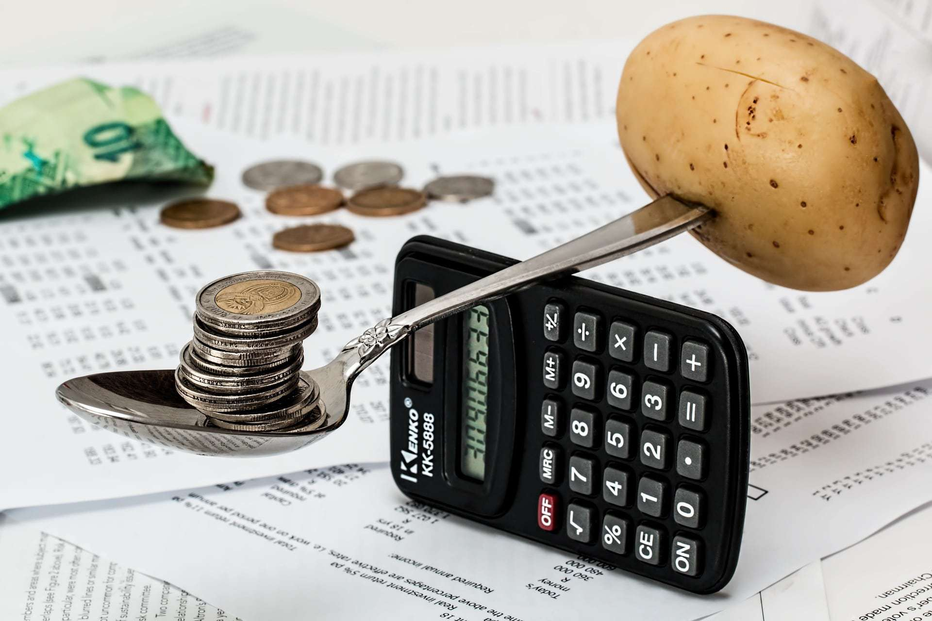Potato and coins on a calculator -- You can find lots of surprise birthday party ideas even if you're on a budget