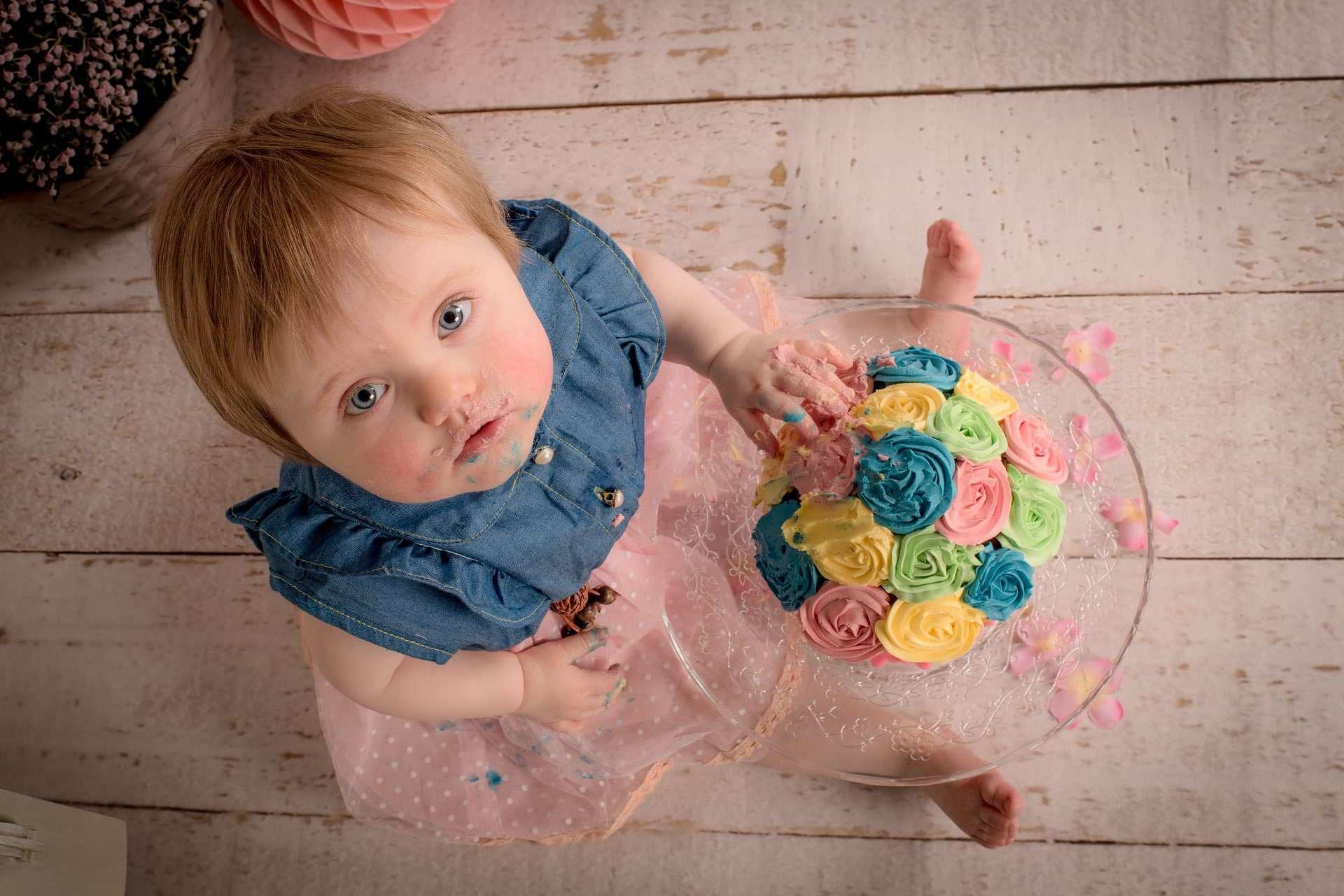 a 2 year old kid enjoying sweets