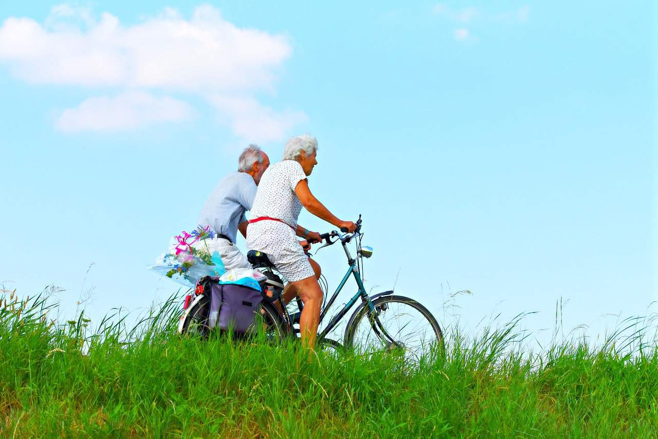 elderly couple biking on their 60th birthday