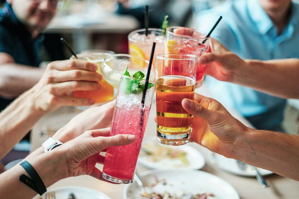 people drinking cocktail and doing some toast
