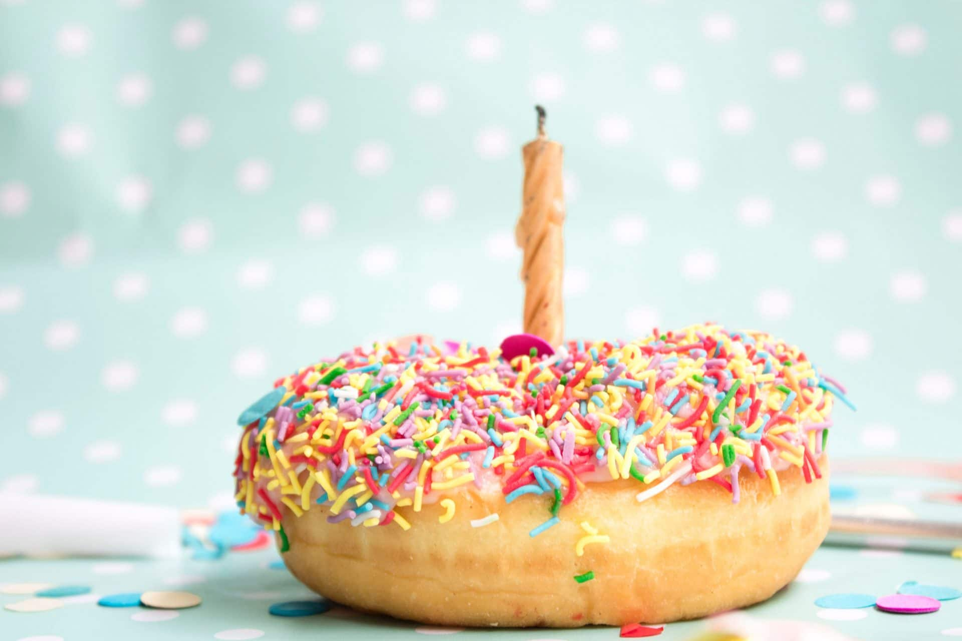 donut with sprinkles and candle