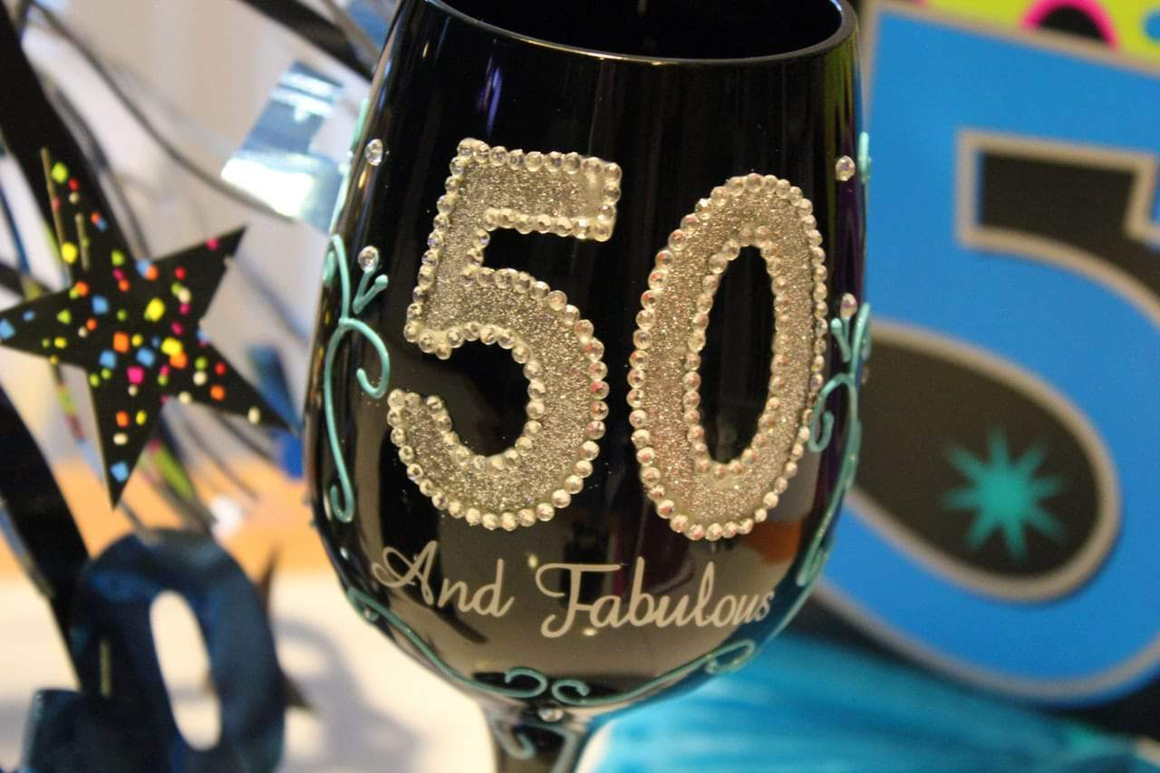 Gold and black stemware features in many 50th birthday party themes