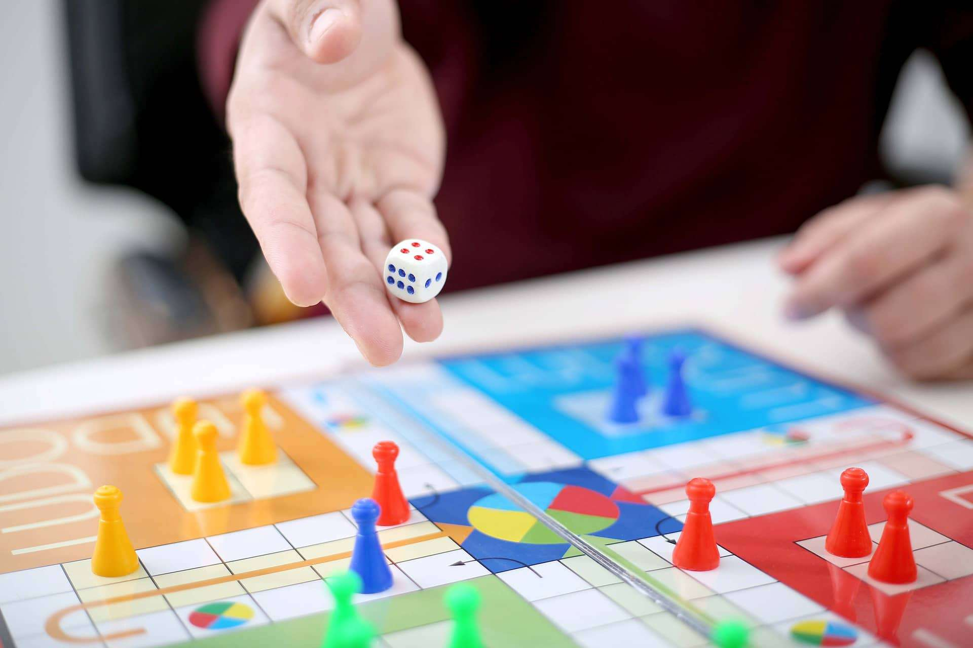 Man holding the dice and ready to release it to win for the game